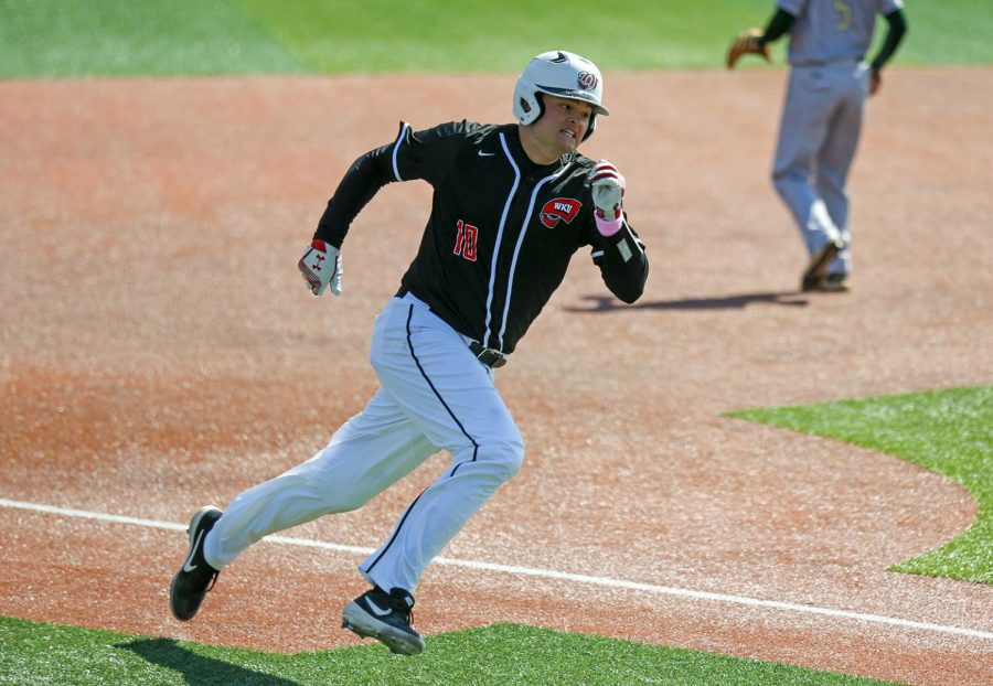 Infielder Davis Sims rounds third base heading toward home to score one run during WKU's win 5-3 against University of Alabama in Nick Denes Field on Sunday, March 17.