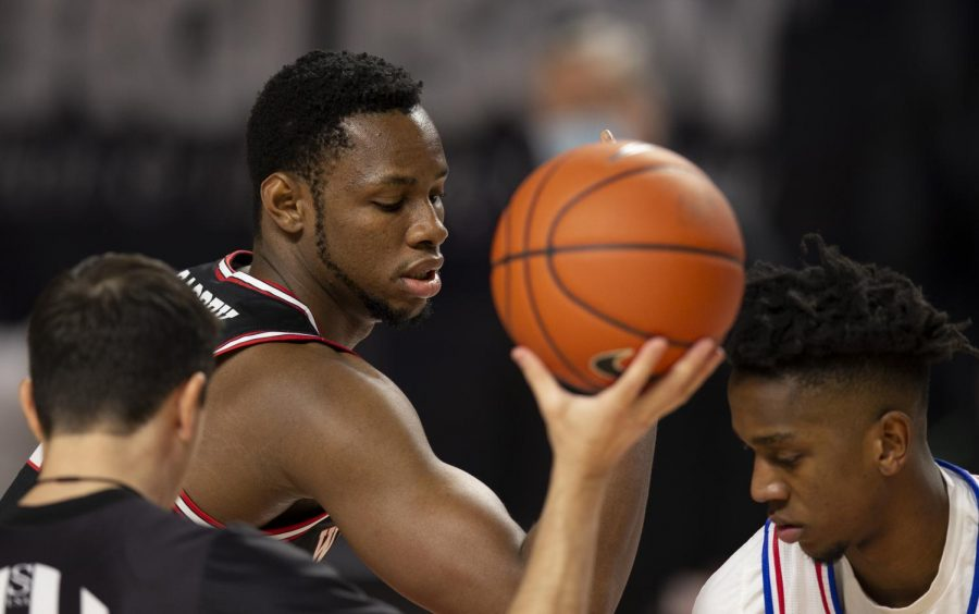 WKU Hilltopper junior center Charles Bassey (23) calms himself for the tipoff at the game against the LA Tech Bulldogs on Jan. 9, 2021 in Diddle Arena.