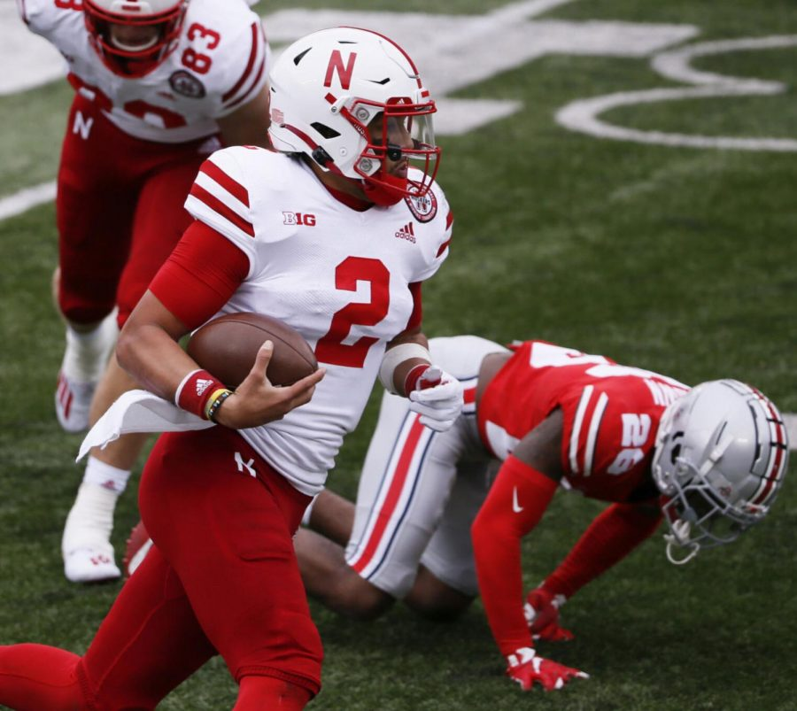 Nebraska quarterback Adrian Martinez (2) runs the ball against Ohio State last month at Ohio Stadium in Columbus, Ohio. The Nebraska quarterback said the Huskers know they have to make individual sacrifices to make the season work amid pandemic.
