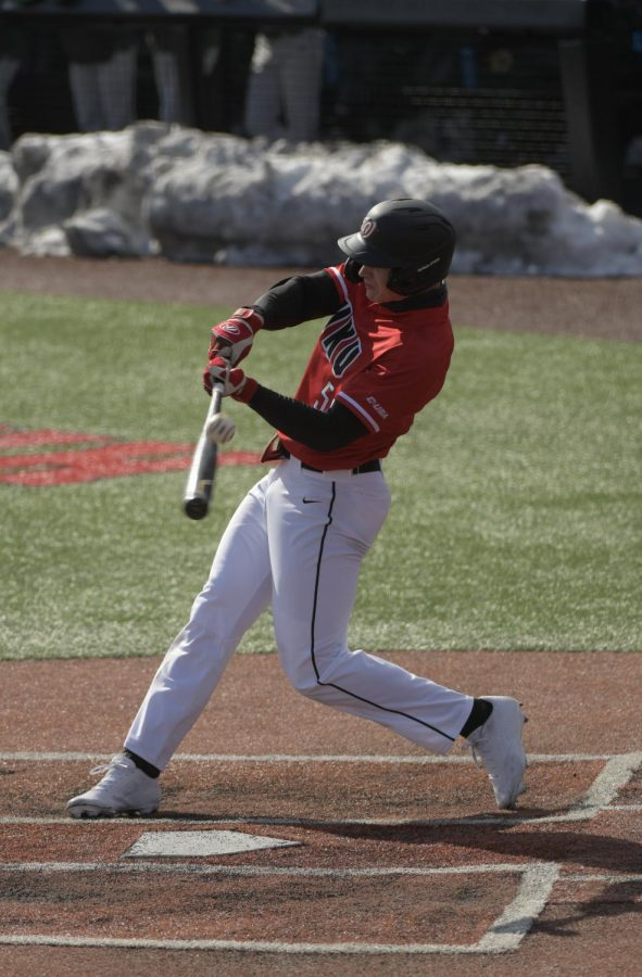 Hilltopper Outfielder Jackson Gray (51) misses a swing in WKU's doubleheader against North Dakota on Monday, Feb. 22.