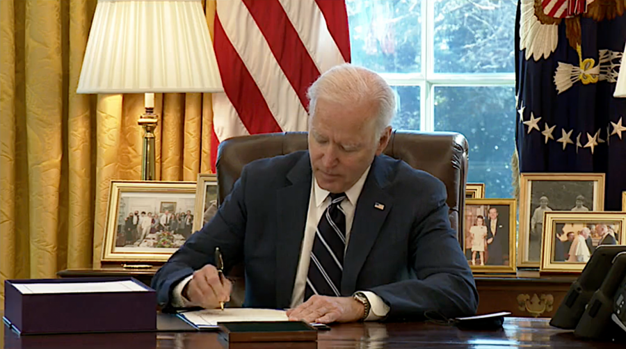 President+Joe+Biden+signs+the+American+Rescue+Plan+package+of+legislation+March+11%2C+2021%2C+at+in+the+Oval+Office+at+the+White+House.