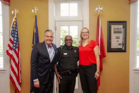 Melissa Bailey (right) was sworn in to the WKUPD on October 1, 2018. In attendance was WKU President Tim Caboni (left), Mitchell Walker (middle) and Bailey