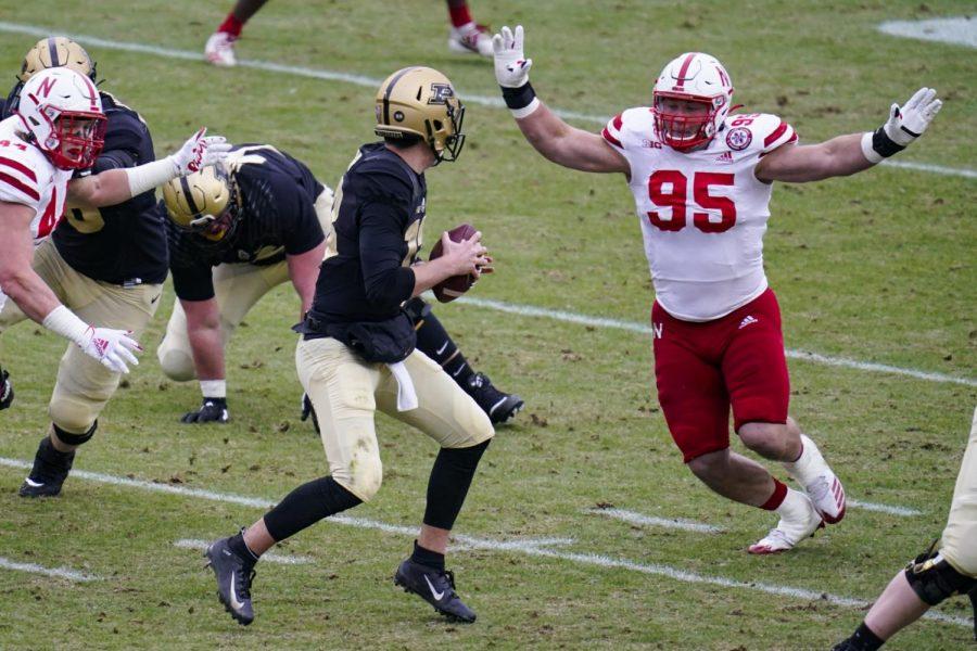 Nebraska defensive lineman Ben Stille (95) pressures Purdue quarterback Jack Plummer during the second quarter Dec. 5 in West Lafayette, Ind.