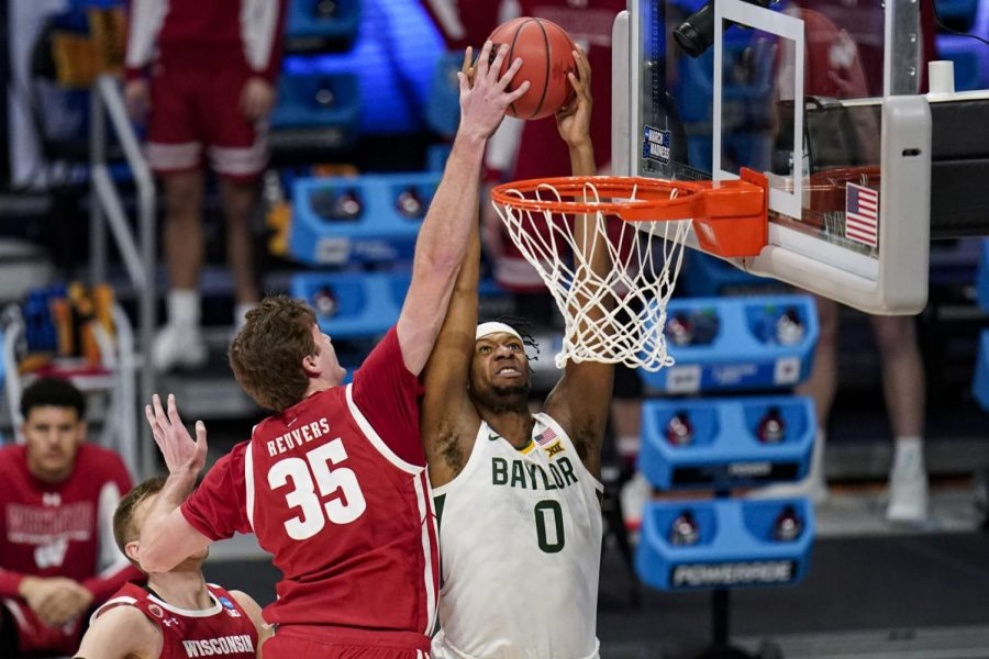 Wisconsin forward Nate Reuvers (35) blocks the dunk attempt of Baylor forward Flo Thamba (0) in the first half of a second-round game in the NCAA men's college basketball tournament at Hinkle Fieldhouse in Indianapolis, Sunday, March 21, 2021.