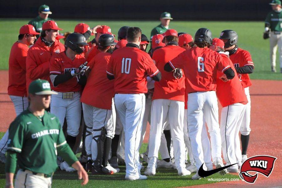 The+WKU+Baseball+team+celebrating+the+10th+inning+walk-off+hit+by+freshman+Eric+Riffe+to+take+down+Charlotte+17-16.%C2%A0