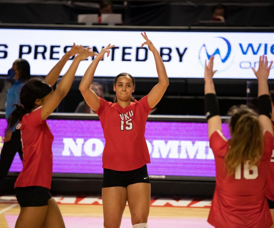 Western Kentucky University's Kayland Jackson (15) celebrates with her teammates after getting a big kill in the set during their Jan. 31 match against Evansville.