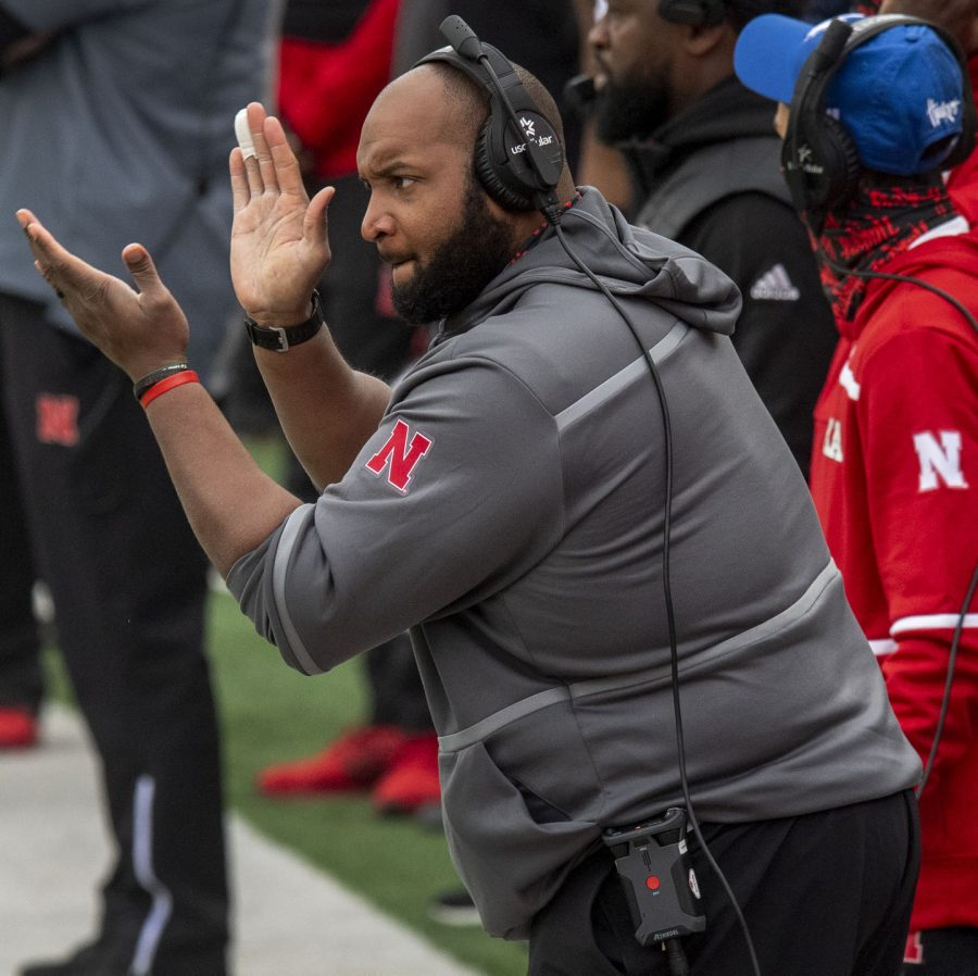 Nebraska offensive line coach Greg Austin claps on the sideline in the first half against Illinois in November at Memorial Stadium.