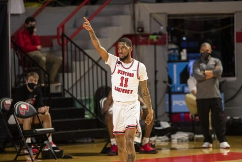 WKU basketball's Taveion Hollingsworth points across court to a teammate after a good assist during their game against Old Dominion on March 5, 2021.