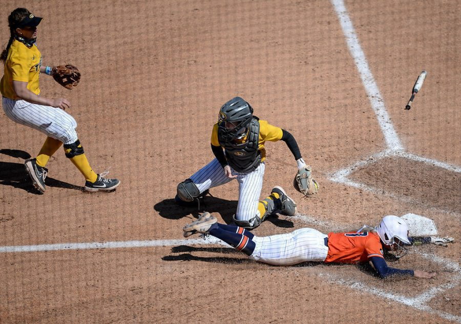 Auburn+sophomore+Maddison+Koepke+slides+to+the+home+base+as+Missouri+senior+Hatti+Moore+tries+to+tag+her+out+Sunday+at+Mizzou+Softball+Stadium.+Moore+was+at+bat+three+times%2C+striking+out+twice.