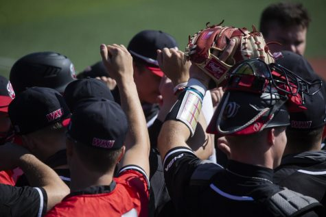 The WKU Baseball team huddles up prior to the first Conference USA series against Charlotte on March 26, 2021.