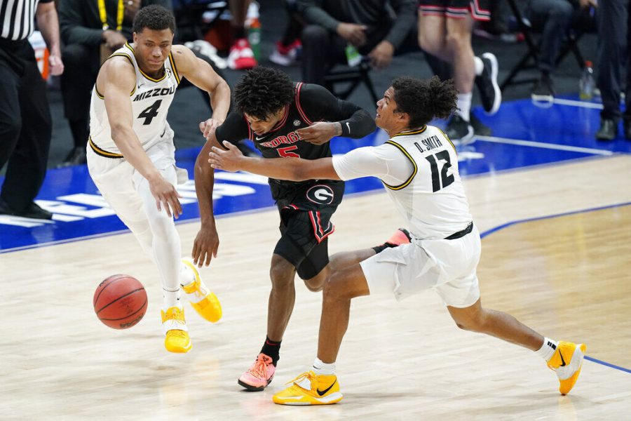 Georgia's Justin Kier (5) tries to get past Missouri's Javon Pickett (4) and Dru Smith (12) in the first half of a game in the Southeastern Conference Tournament on March 11 in Nashville, Tenn. Missouri and Dru Smith take on Austin Reaves and Oklahoma on Saturday in the NCAA Tournament.