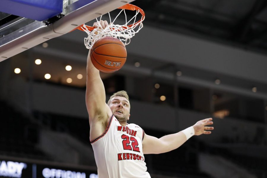 WKU redshirt senior Carson Williams slams home a dunk on March 11, 2021. The Hilltoppers played UTSA in the quarterfinals of the C-USA Championship Tournament.