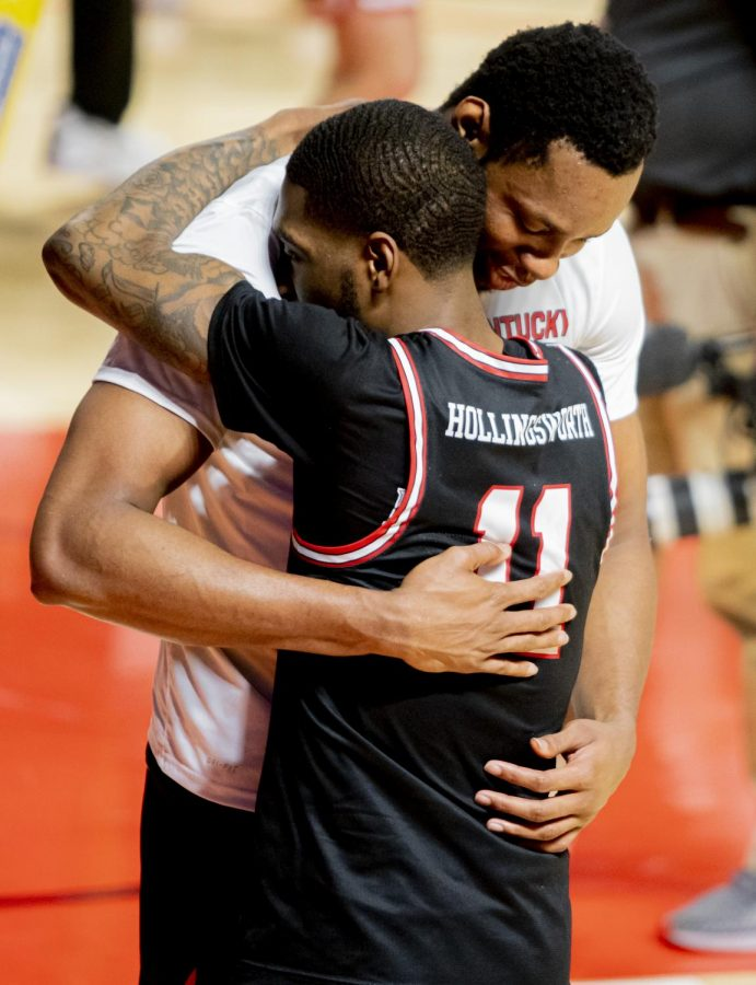 Charles Bassey (23) and WKU Senior guard, Taveion Hollingsworth (11) celebrate with a hug after the game against Old Dominion on Saturday, March 6, 2021.