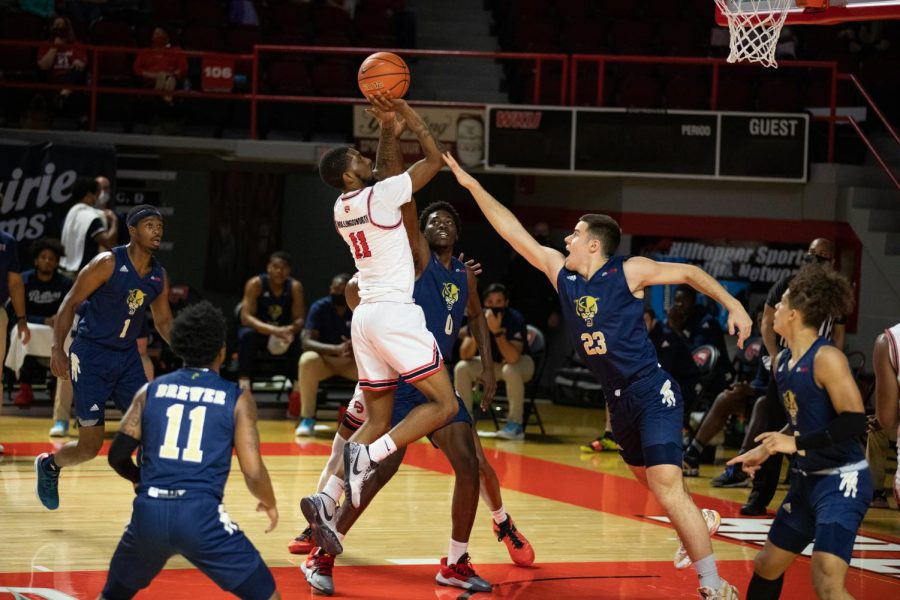 Taveion+Hollingsworth+drives+in+and+shoots+a+floater+over+FIU+Panthers+defender+Petar+Krivokanic+%2823%29+as+Western+Kentucky+picks+up+a+win+over+FIU+58+to+91+on+Feb.+28%2C+2021.
