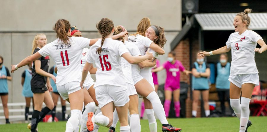 The Lady Toppers celebrate freshman Annah Hopkins' goal against Louisville on March 27, 2021.
