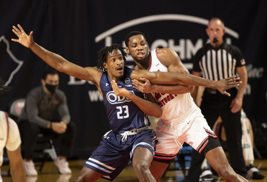 Old Dominion's Austin Trice (23) attempts to post up WKU Hilltoppers Charles Bassey (23) as WKU falls to Old Dominion on March 5, 2021.