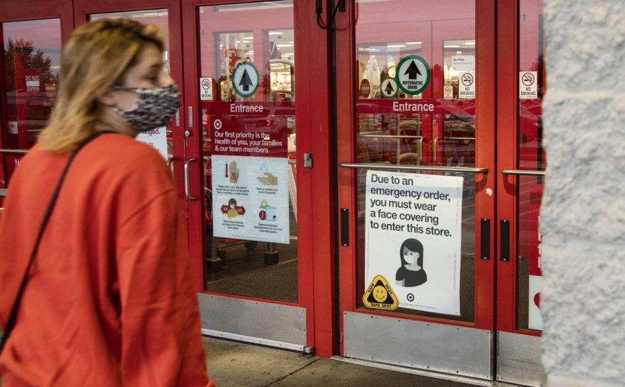 People walk into Target in Bowling Green, KY. Target is among the many other stores across Bowling Green that have put up signs informing customers to wear face coverings.