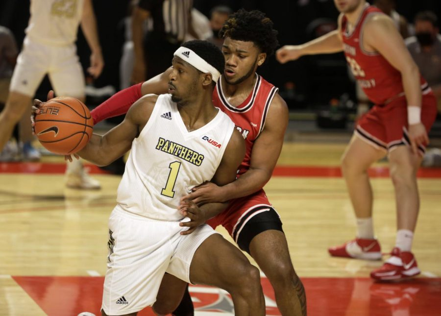 WKU+Hilltoppers+freshman+Dayvion+McKnight+guards+FIU+Panthers+junior+Isaiah+Banks+during+the+game+on+March+1%2C+2021.