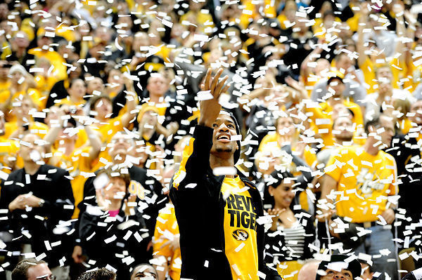 Kim English reaches for confetti in this 2012 file photo. English was hired as George Masons head coach Tuesday.