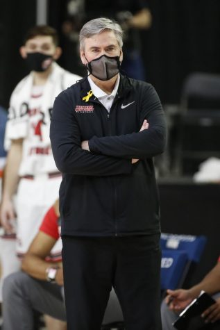 WKU head coach Rick Stansbury standing on the sideline while his team plays against UTSA on March 11, 2021. WKU won 80-67 over the Roadrunners advancing to the Semi-final against UAB.