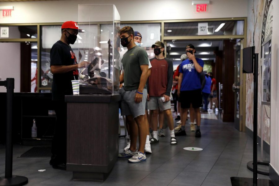 Students stand in line at the food court in Downing Student Union on August 27. After several days of long lines that go against social distancing guidelines, the food court at DSU has been updated with barriers and markers to keep students spaced apart.