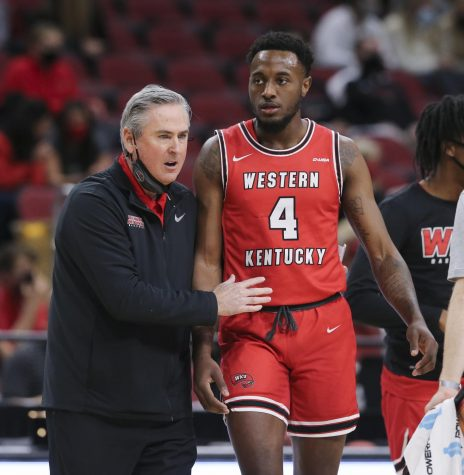 Western Kentucky head coach Rick Stansbury instructing Josh Anderson (4) against Louisville during their game at the KFC Yum! Center in Louisville, Ky. on Dec. 1, 2020.