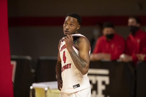 WKU Hilltopper Josh Anderson (4) checks the instant replay after a foul call during their game against Old Dominion on March 5, 2021.
