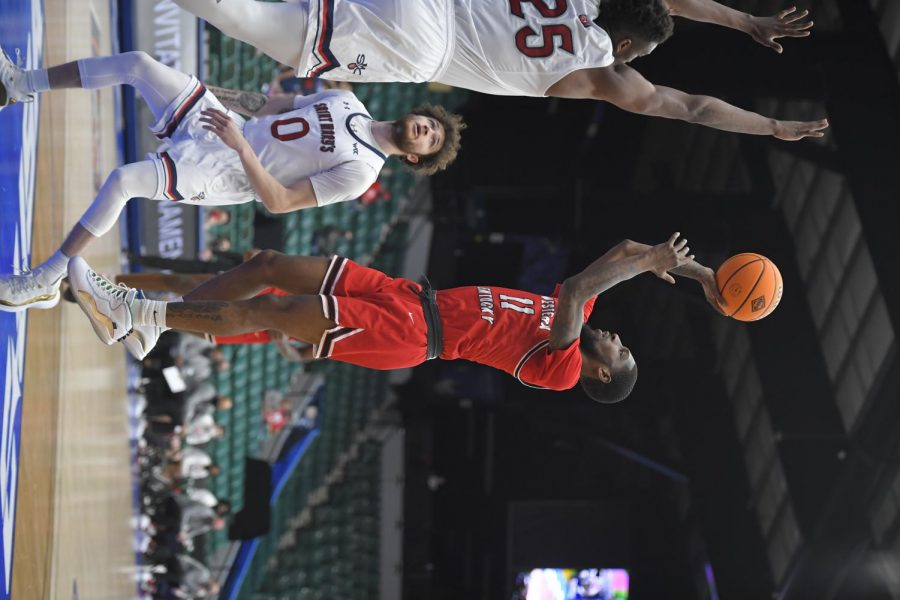 Senior Taveion Hollingsworth (11) attempting a jumper against Saint Mary's on March 17, 2021. WKU went on to win 69-67 and advanced to the quarterfinals of the NIT.
