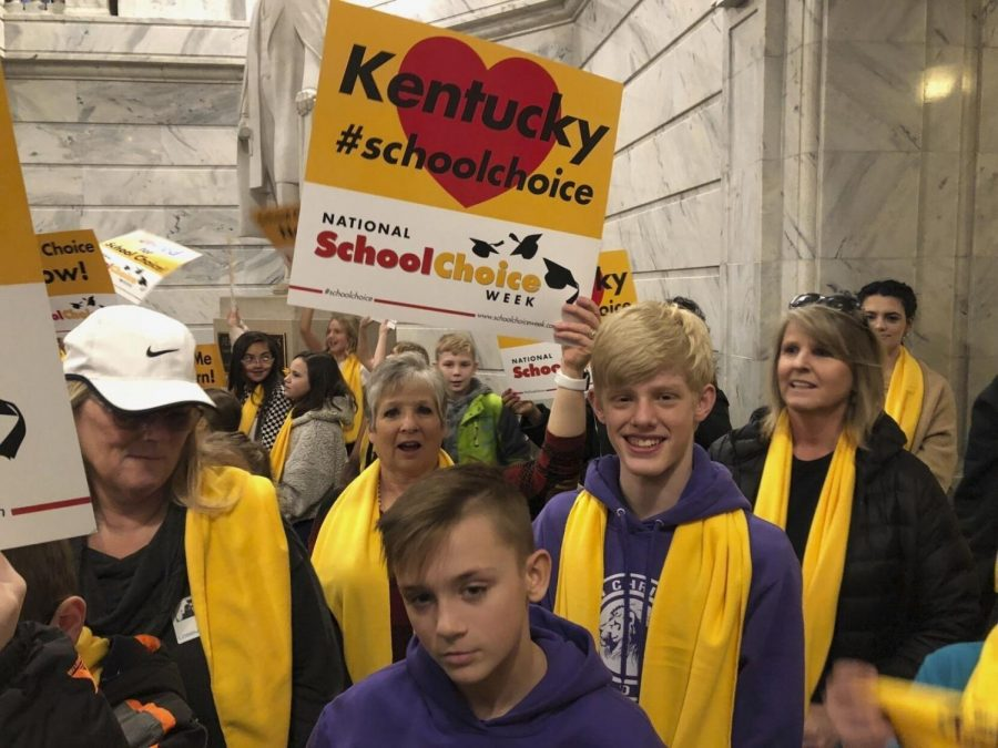 School choice advocates rally at the Kentucky Capitol in Frankfort, Ky., on Monday, Jan. 27, 2020. They are supporting legislation that would give tax credits to people who donate to scholarship funds for special-needs children or those in low-income homes to attend private schools.