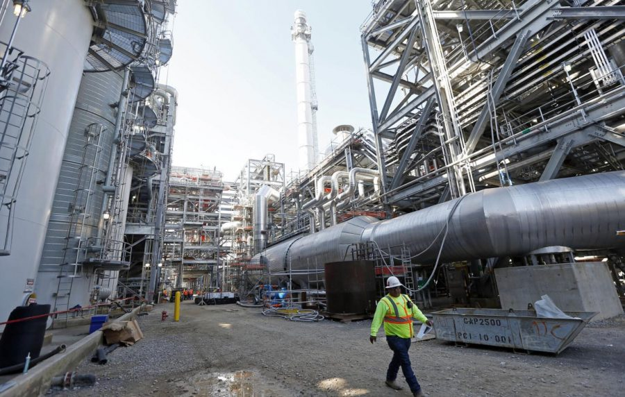 In this Nov. 16, 2015 file photo, a worker walks through a section of the Mississippi Power Co. carbon capture plant in DeKalb, Miss.
