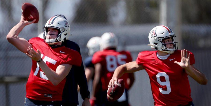 Quarterbacks Will Plummer, left, and Gunner Cruz work on drop backs during drills for the University of Arizona spring season, Tucson, Ariz., March 27, 2021.