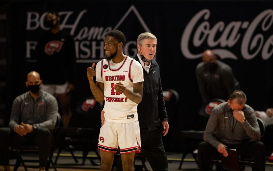 WKU+Hilltoppers+head+coach+Rick+Stansbury+attempts+to+keep+senior+guard+Taveion+Hollingsworth+%2811%29+in+high+spirits+after+WKU+picks+up+a+loss+to+Old+Dominion+on+March+5%2C+2021.