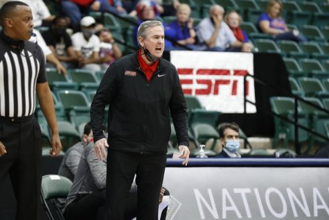 WKU head coach Rick Stansbury yelling at his team while playing in the NIT basketball tournament on March 25, 2021.