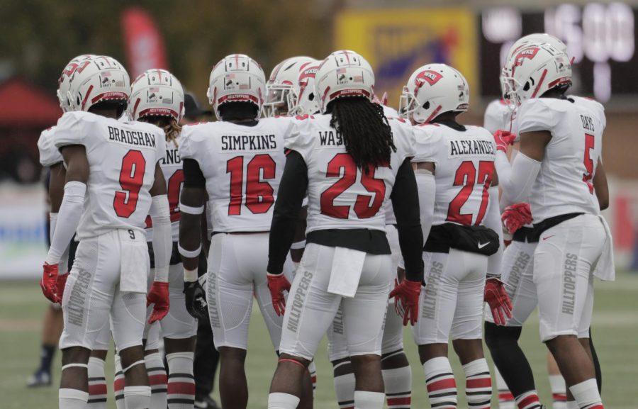 Western Kentucky University defense huddles up before the next snap during their home game on Oct. 24, 2020.