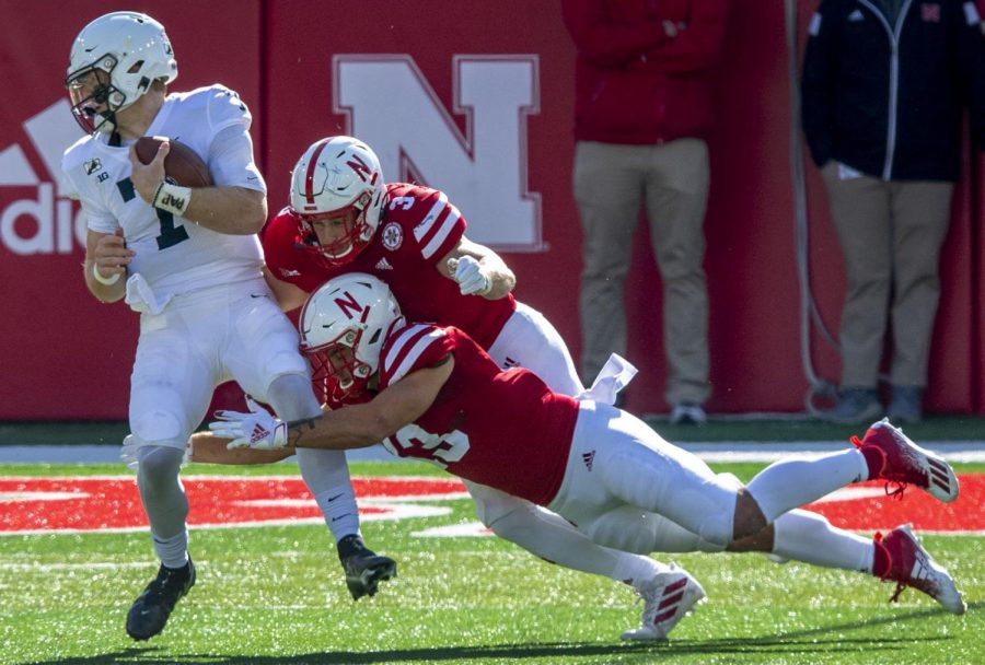 Penn State quarterback Will Levis (7) gets tackled by Nebraska's JoJo Domann (13) and Will Honas (3) on Nov. 15 at Memorial Stadium.