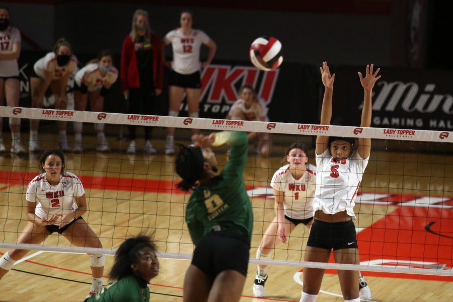 WKU junior middle hitter Lauren Matthews (5) attempts to block an incoming spike during a game against the Charlotte 49ers on February 21, 2021 at the EA Diddle Arena in Bowling Green, Ky., where WKU won 3-0.