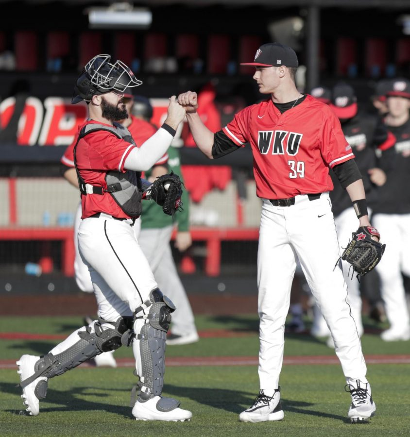 WKU pitcher Hunter Crosby (39) fist-bumps catcher Matt Phipps (25) after defeating Wright State 7-2 at Nick Denes Field on Feb. 22, 2020.