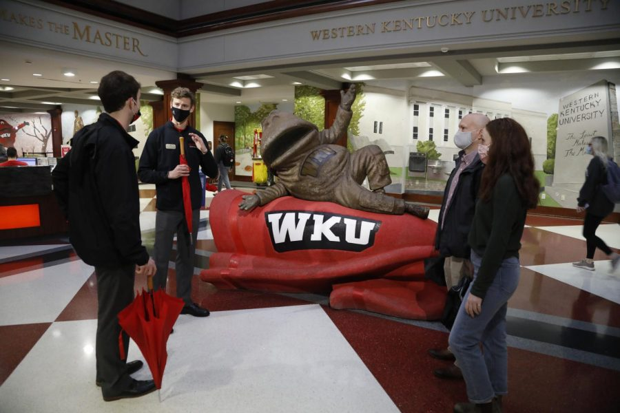 WKU+Spirit+Masters+and+Juniors+John+Downing+and+Matthew+Wininger+give+a+tour+to+a+prospective+freshman+and+family+inside+Downing+Student+Union+on+March+15.+Spirit+Masters+are+the+official+student+ambassadors+who+are+responsible+for+preserving+traditions%2C+striving+for+excellence%2C+and+making+the+spirit+of+WKU+contagious.+With+in-person+classes+and+living%2C+Spirit+Masters+are+still+able+to+continue+the+tradition+of+giving+one-on-one+tours+to+prospective+students+and+their+families+both+in-person+and+virtual.