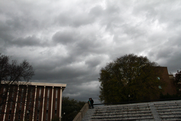 As storm clouds roll in from the west a couple embraces on the Colonnade before the rain. WKU sent out a text message at 10:15 a.m. warning students, faculty and staff of a severe weather.