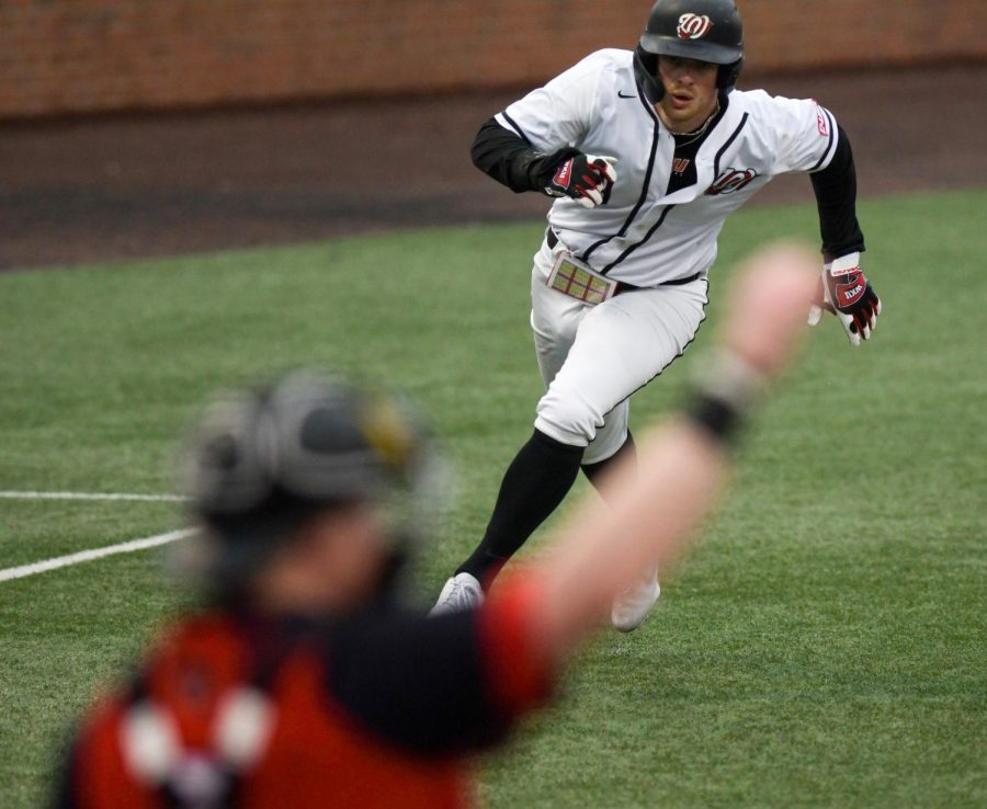WKU infielder Jack Wilson (9) runs home to score at the baseball game at Nick Denes Field on Feb. 27, 2021. WKU lost 11-3.