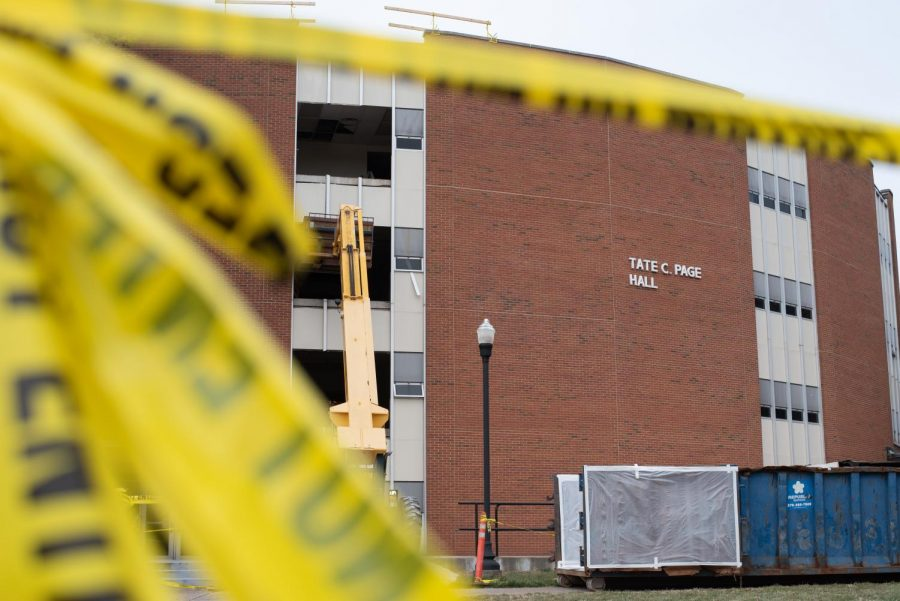 The demolition of Tate C. Page Hall began on Wednesday, March 10, with work crews removing windows from part of the building that faces Normal St. The demolition comes as the First Year Village, two new residence halls near Tate Page, nears completion.