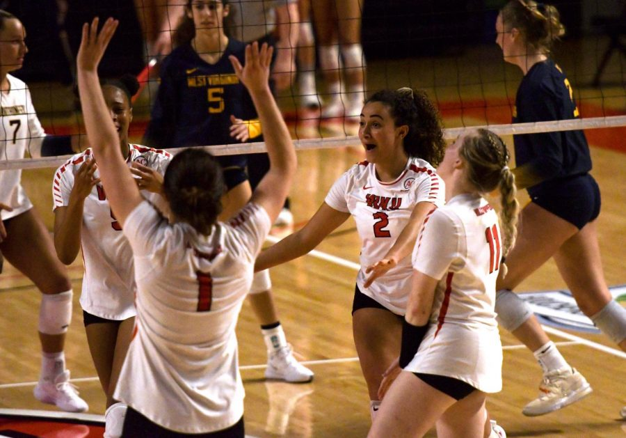 The WKU volleyball team celebrates as they extend their lead over West Virginia during the fourth set during the game in Diddle Arena on Mar. 12, 2021. WKU won 3-1.
