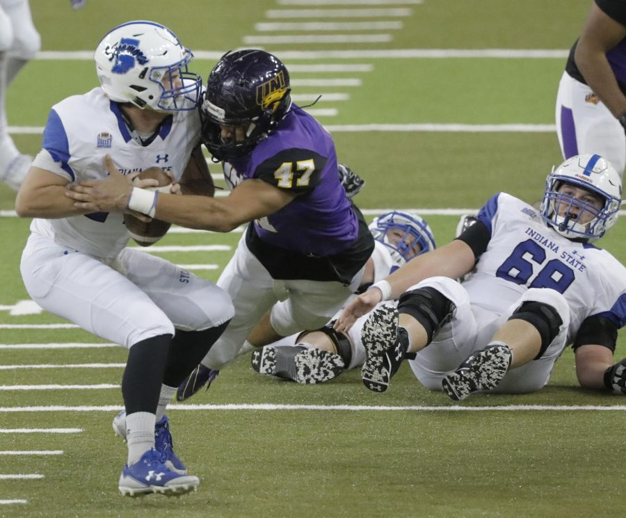 Northern Iowa's Elerson Smith, center, sacks former Indiana State quarterback Isaac Harker in a game in 2017.