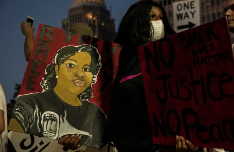"Protestors gathered for a second night in downtown Louisville on the evening of May 29, 2020. The protests were spurred by the death of Breonna Taylor at the hands of police, and lasted into the night and early morning. Phrases such as ""no justice, no peace"" were shouted by crowd members. Vandals broke windows of buildings, police cars, and spray painted on walls across downtown. The police used tear gas and rubber bullets on protestors."