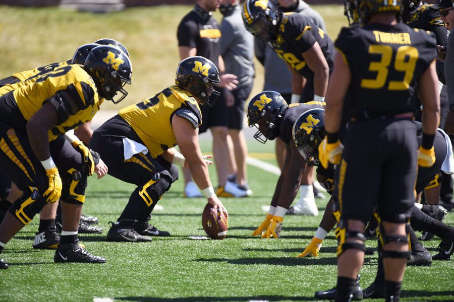 Offensive+lineman+Michael+Maietti+prepares+to+snap+the+ball+during+a+drill+Saturday+at+Faurot+Field+prior+to+MU%E2%80%99s+Black+and+Gold+Spring+Game.