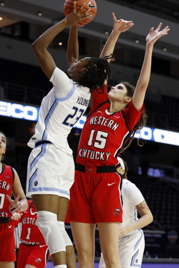 Senior Raneem Elgedawy attempting to block Monarch junior Amari Young's shot in the first half of the preliminary round of the C-USA Tournament on March 9, 2021.