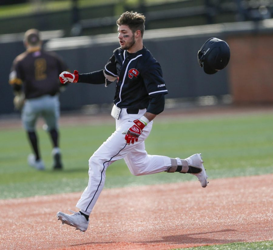 WKU's Ray Zuberer III (13) loses his helmet while running to second base against Valparaiso at Nick Denes Field on Feb. 15, 2020. WKU won 9-3.