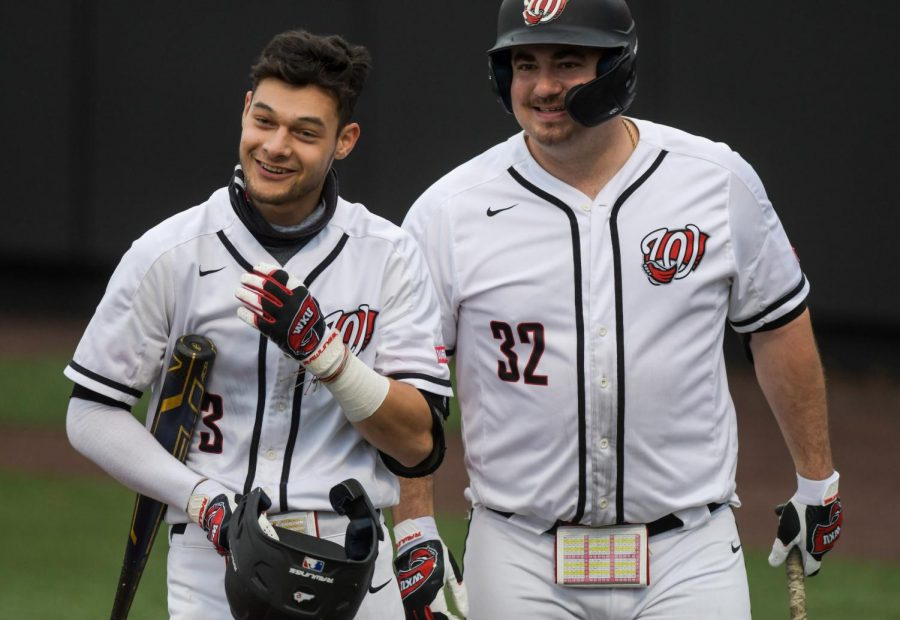 WKU infielder Eric Riffe (3) is congratulated by his team after making a home run and scoring the first run of the game for WKU at the baseball game at Nick Denes Field on Feb. 27, 2021. WKU lost 11-3.