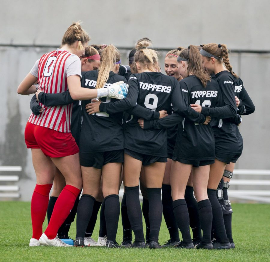 The WKU Soccer team huddled up before the game against Marshall Thursday, March 18, 2021 at the WKU Soccer Complex.