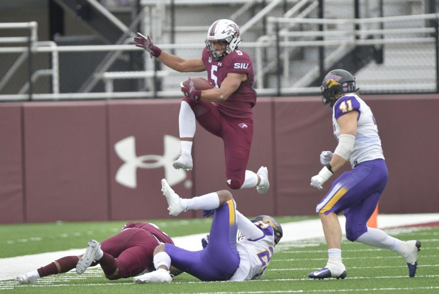 SIU+running+back+Justin+Strong+%285%29+hurdles+over+Northern+Iowa+defensive+back+Omar+Brown+%2824%29+during+the+third+quarter+at+Saluki+Stadium+on+Saturday+in+Carbondale.